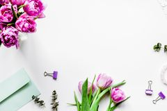 Spring flowers on workdesk at home white background top view moc Royalty Free Stock Photos