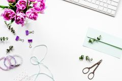 Spring flowers on workdesk at home white background top view moc Royalty Free Stock Image