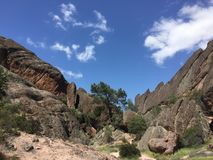 Pinnacles national park machete Ridge with trees and clouds Stock Photos