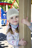 In the spring on the playground playing little girl. Royalty Free Stock Photos