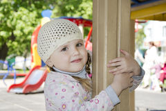 In the spring on the playground playing little girl. Stock Photo