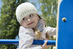 In the spring on the playground playing little girl. Stock Image