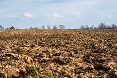Spring plowed land for planting crops. Field Stock Image