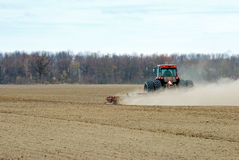 Spring plowing a dry farm field Stock Photography