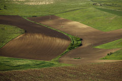 Spring plowing land. Stock Photos