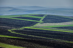 Spring plowing land. Spring plowing land in Transylvania Royalty Free Stock Photos