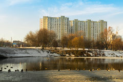 Spring pond in the city on the background of the house. Moscow 10 March 2016 royalty free stock images