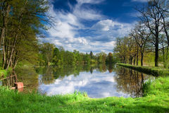 Spring pond landscape. View with blue sky and clouds Stock Photos