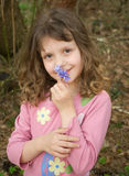 Spring portrait. Portrait of a beautiful girl of preschool age with snowdrops Stock Image