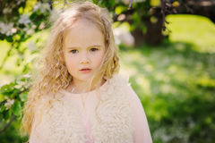 Spring portrait of beautiful dreamy curly 5 years old child girl Stock Photo