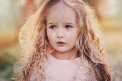 Spring portrait of beautiful dreamy curly 5 years old child girl Royalty Free Stock Images