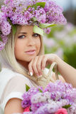 Spring portrait of a beautiful girl with lilac. Royalty Free Stock Photography