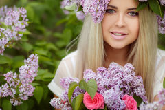 Spring portrait of a beautiful girl with lilac. Royalty Free Stock Photos