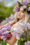 Spring portrait of a beautiful girl with lilac. Stock Images