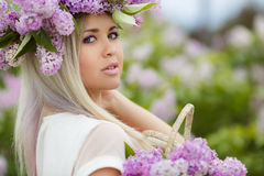 Spring portrait of a beautiful girl with lilac. Stock Photos