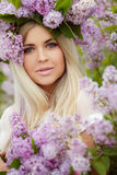 Spring portrait of a beautiful girl with lilac. Royalty Free Stock Images
