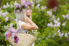 Spring portrait of a beautiful girl with lilac. Royalty Free Stock Photo