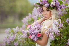 Spring portrait of a beautiful girl with lilac. Stock Image