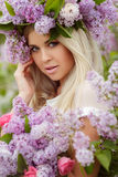 Spring portrait of a beautiful girl with lilac. Stock Photography