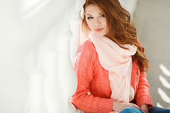 Spring portrait of a beautiful woman in the city. Royalty Free Stock Images