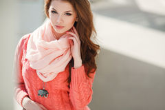 Spring portrait of a beautiful woman in the city. Stock Photos