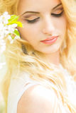 Spring portrait of a beautiful young blonde woman. Stock Image