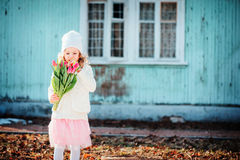 Spring portrait of child girl with tulips bouquet for woman's day Stock Image