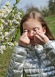 Spring portrait of cute little girl child has allergy to spring blossoming royalty free stock photography