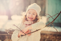 Spring portrait of cute smiling child girl in pastel vintage tones Royalty Free Stock Images