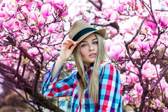 Spring portrait of cute young blonde woman in hat with flowers Royalty Free Stock Photo