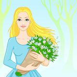 Spring. portrait of the girl with snowdrops Stock Photos