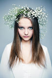 Spring portrait  girl with wreath of flowers Stock Photo