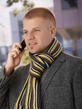 Spring portrait of guy with cellphone Royalty Free Stock Images