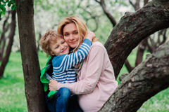 Spring portrait of happy pregnant mother enjoying warm day with child son Royalty Free Stock Photography