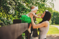 Spring portrait of mother and baby daughter playing outdoor in matching outfit - long skirts and shirts Stock Photography