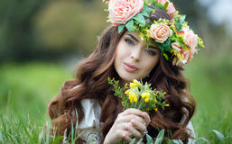 Spring Portrait Of A Beautiful Woman In A Wreath Of Flowers Royalty Free Stock Photos