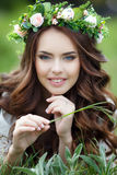 Spring Portrait Of A Beautiful Woman In A Wreath Of Flowers Stock Photo