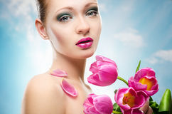 Spring portrait with tulips Royalty Free Stock Photography