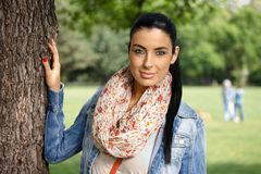 Spring portrait of pretty girl in the park smiling Stock Photography