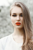 Spring portrait of a pretty woman with red lips. Royalty Free Stock Images