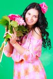 Spring portrait of a pretty young brunette with a bunch of gerbe Stock Image