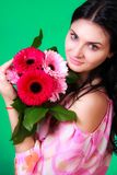 Spring portrait of a pretty young brunette with a bunch of gerbe Royalty Free Stock Photos