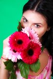 Spring portrait of a pretty young brunette with a bunch of gerbe Stock Images