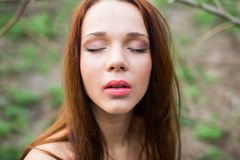 Spring portrait of a red-haired young lady Royalty Free Stock Photos