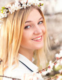 Spring portrait of woman among flowering branches Royalty Free Stock Image