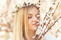 Spring portrait of woman among flowering branches Stock Photography