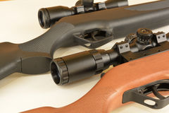 Spring powered modern airguns with scopes Stock Photography