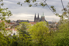 Spring Prague City with gothic Castle and the green Nature and flowering Trees, Czech Republic Royalty Free Stock Photography