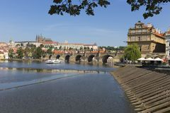 Spring Prague gothic Castle with the Lesser Town above River Vltava in the sunny Day, Czech Republic. Spring Prague gothic Castle with the Lesser Town above stock images