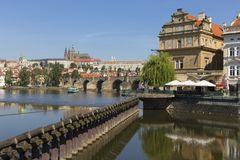 Spring Prague gothic Castle with the Lesser Town above River Vltava in the sunny Day, Czech Republic. Spring Prague gothic Castle with the Lesser Town above stock image